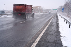 truck on highway in snowy day